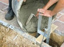 Fondations poteaux H d'ancrage dalle béton