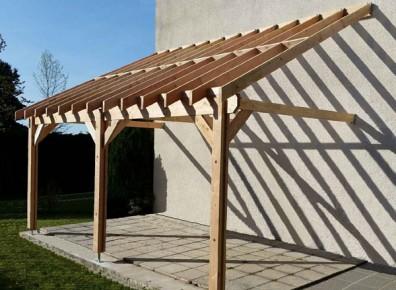 Ossature bois toit plat abri bois et charpentes avec for Charpente bois une pente